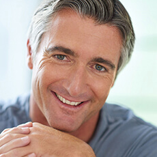 man smiling with dental implants in Pea Ridge