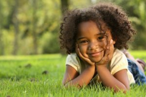child smiling curly hair