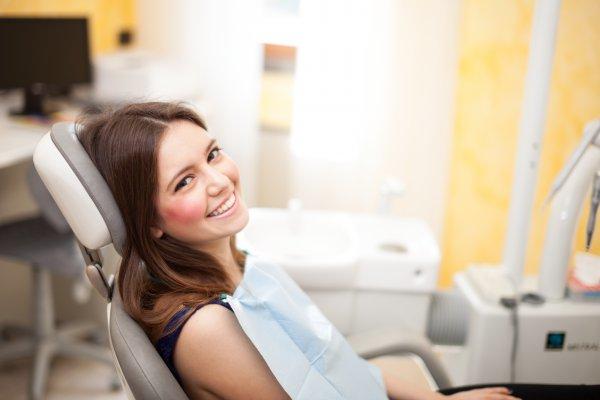 A woman waiting to her Bella Vista dentist.
